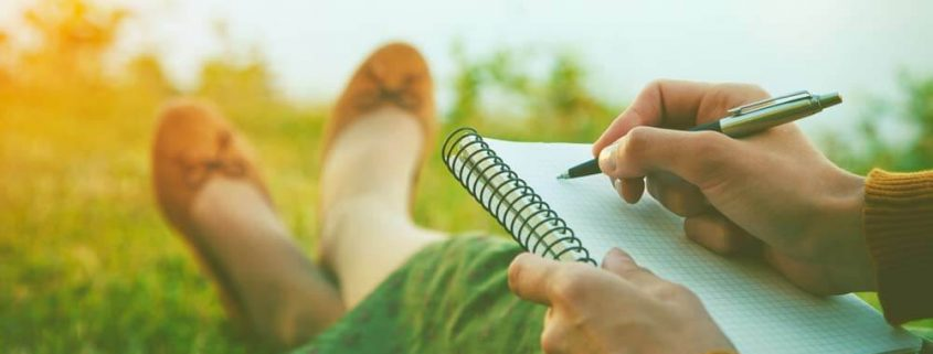 Girl Writing in Notebook - Self Publishing Tips by Jill Hughes