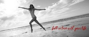 Woman Jumping at the Beach: Quote: Fall in Love with your Life - Awakening Alchemy
