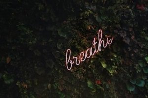 Neon Sign says Breathe - Awakening Alchemy