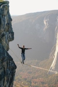 Man Crossing a High Valley on a Tightrope - Awakening Alchemy