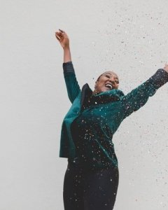 Woman in Business Suit Jumps For Joy, Outside - Awakening Alchemy