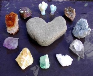 Crystals Gathered in a Circle around a Heart-Shaped Rock - Awakening Alchemy