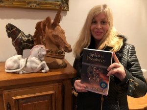 Jill Hughes Holding a Copy of Spirit of Prophecy