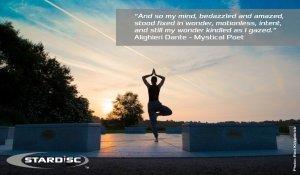 Person Meditating at Sunset on Top of StarDisc - Awakening Alchemy