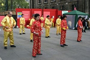 Falun Gon Members in Red and Yellow Costumes Dance - Awakening Alchemy