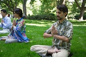 Falun Gong Exercises - Two Practitioners sitting on grass in Lotus Position - Awakening Alchemy