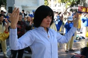 A Granny Prectices Falun Gong - Hands above Head - Awakening Alchemy