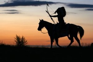 Native American at Sunset on a Horse, Hunting with Bow - Awakening Alchemy