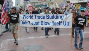 Awakening Alchemy - People Protesting With Sign - WTC7 Didn't Just Blow Itself Up