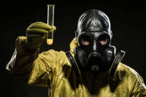 Awakening Alchemy - Biological Warfare - Man in Mask, Goggles and Hazmat Suit Holding a Vial of Virus to Spread