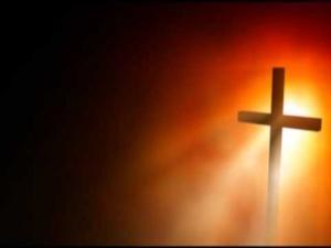 Golden Christian Cross Illuminated by Light