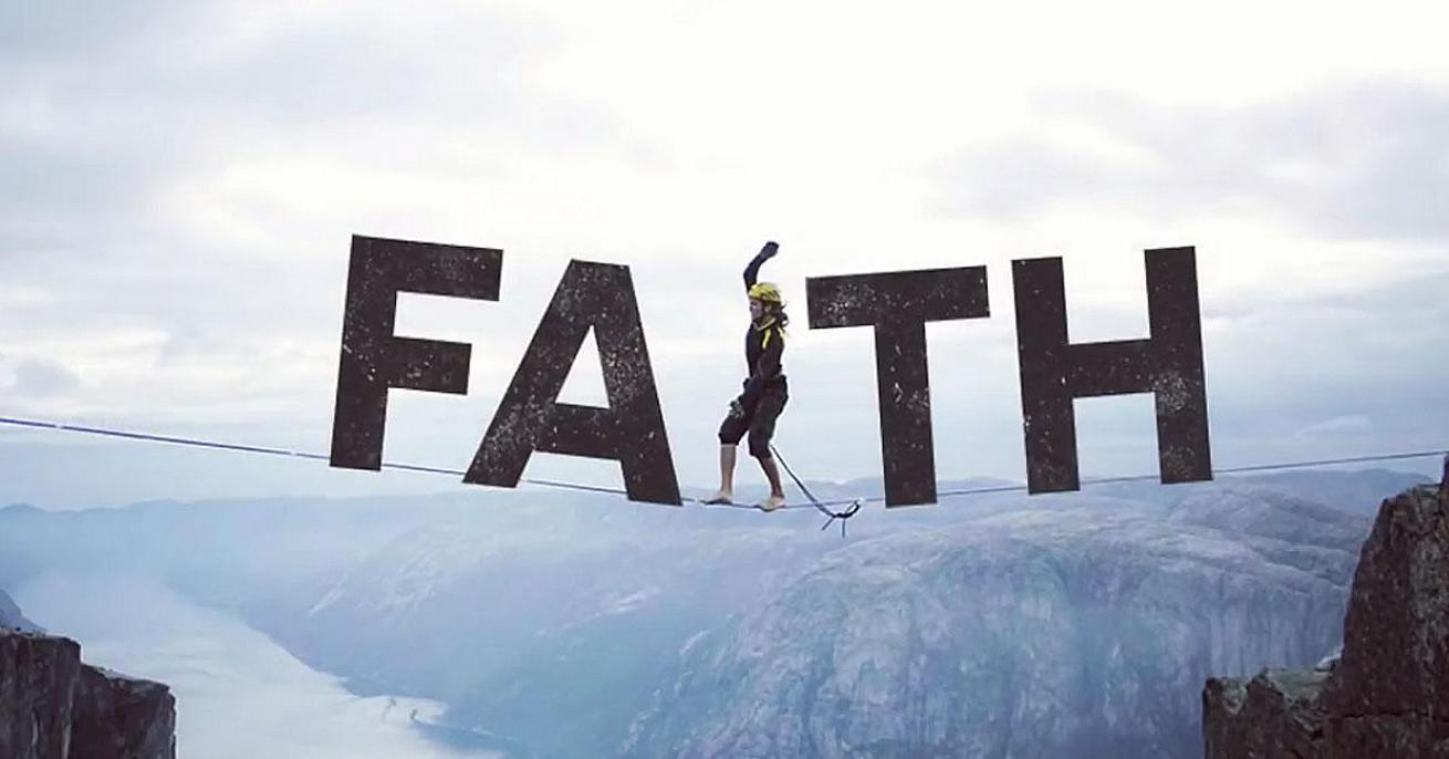"""Man Walking on Tightrope Spelling Out the Word Faith With The Man As the Letter """"I"""""""