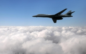 Awakening Alchemy - Heavy USAF Bomber above the white clouds against the blue sky